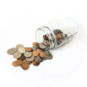 Picture of a jar of coins that has been spilled. This shows the savings you receive when you seek affordable dental care through Lincoln Dental Plans.