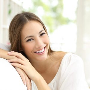 Image of a happy lady who has Lincoln Dental Plans and is able to have a great smile with the coverage of routine dental cleanings.