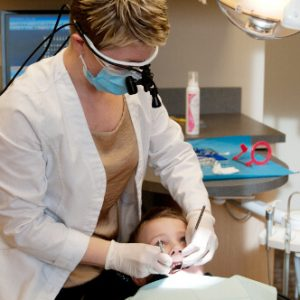 Image of a child receiving a routine dental cleaning, which is important to maintain good oral and overall health.